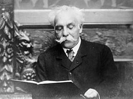 A head and shoulders portrait of a late-middle-aged man of the early twentieth century with white hair and a large white moustache